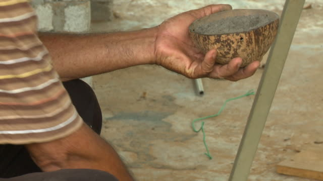 putting soil and plant into coconut shell - menschliches gelenk stock-videos und b-roll-filmmaterial