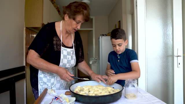 putting some butter on the rolls - french food stock videos & royalty-free footage