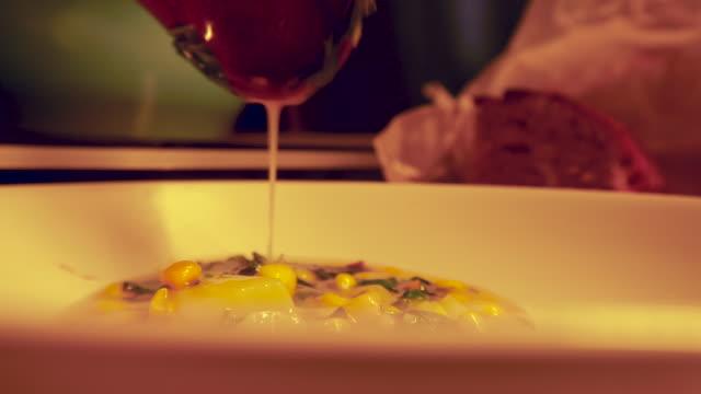 putting soup to plate potato sweet corns pale colour - potato soup stock videos & royalty-free footage