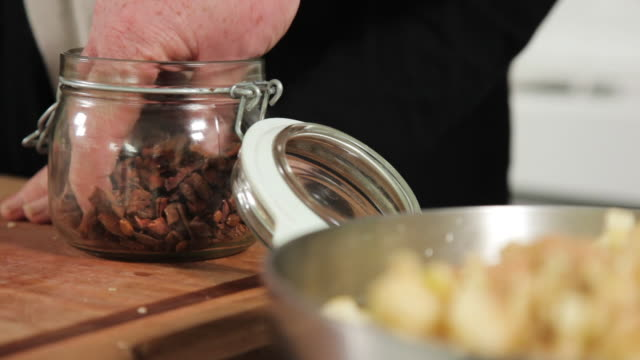 putting star anise to diced apples - star anise stock videos and b-roll footage