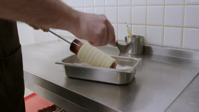 putting sugar-coated chimney cake on a rack - sugar stock videos & royalty-free footage