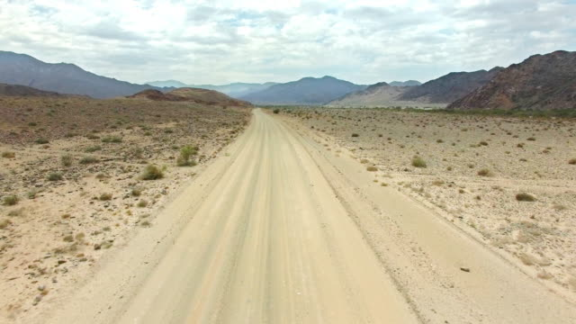 putting the desert miles behind them - pick up truck stock videos and b-roll footage