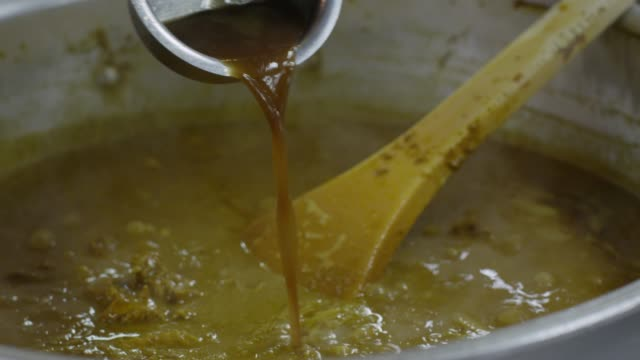putting the sauce on the curry in tokyo, japan - curry powder stock videos and b-roll footage