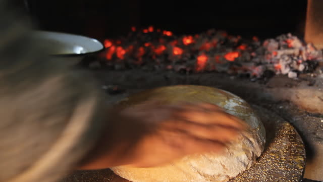 hd: putting yeast dough in brick oven - peasant bread stock videos and b-roll footage