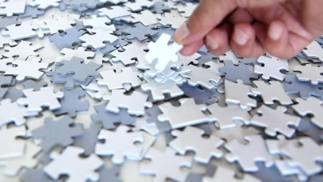 puzzle pieces - incomplete stock videos & royalty-free footage