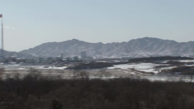 North Korean ice hockey players arrive in South Korea KOREAN DEMILITARIZED ZONE Guards at border between North Korea and South Korea Various shots of...