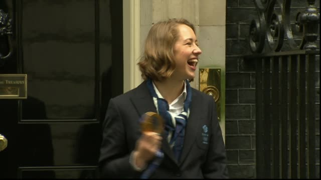 Team GB hopes LIB / 2522014 Downing Street EXT Olympians along to Number 10 Lizzy Yarnold posing with gold medal Yarnold and others posing with...