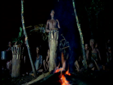 Pygmies play drums at night