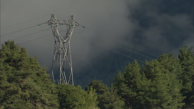 AERIAL WS Pylon surrounded by trees on hill in Maritime Alpes / Rhone-Alpes, France