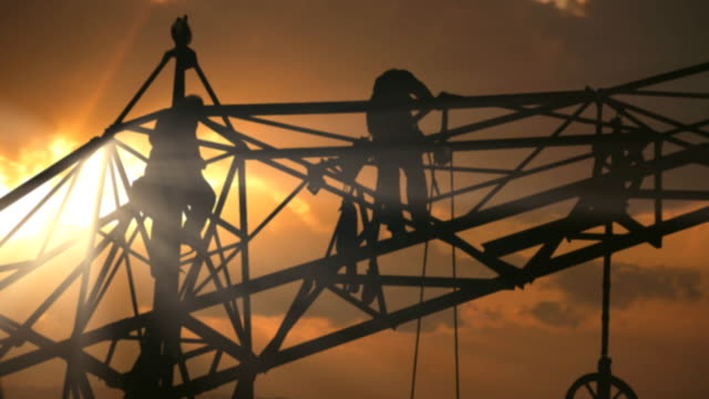 pylon workers sunset - power line stock videos & royalty-free footage