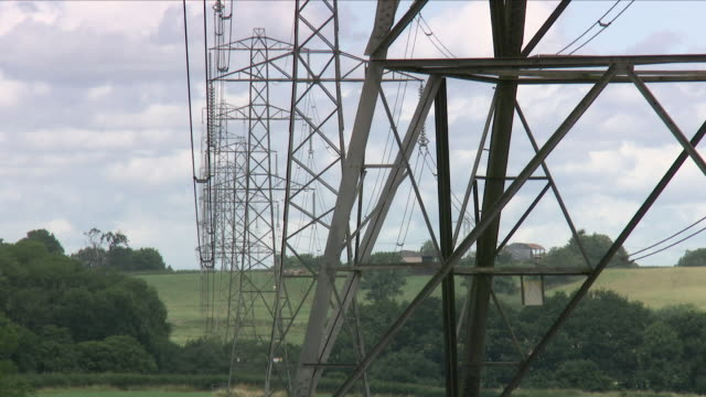 pylons and high tension electricity cables - electricity pylon stock videos and b-roll footage