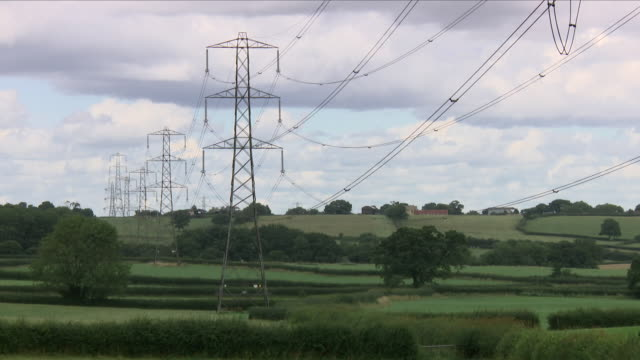 pylons and high tension electricity cables - electricity pylon stock videos & royalty-free footage