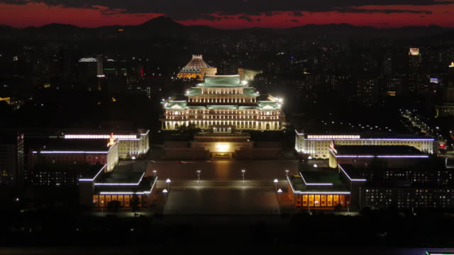 pyongang skyline after sunset with grand people's study house  in pyongyang, north korea, dprk. seen from juche tower. - north korea stock videos & royalty-free footage
