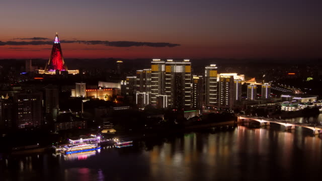 pyongang skyline after sunset with pyramid (ryugyong hotel) and modern buidlings at taedong river,  in pyongyang, north korea, dprk. seen from juche tower. - spoonfilm stock videos and b-roll footage