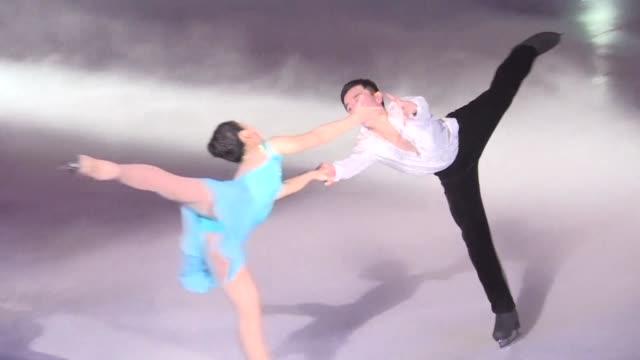 vídeos de stock, filmes e b-roll de pyongyang holds its own figure skating festival on the same day north korea's olympic duo ryom tae ok and kim ju sik successfully reach the pairs... - patinação artística