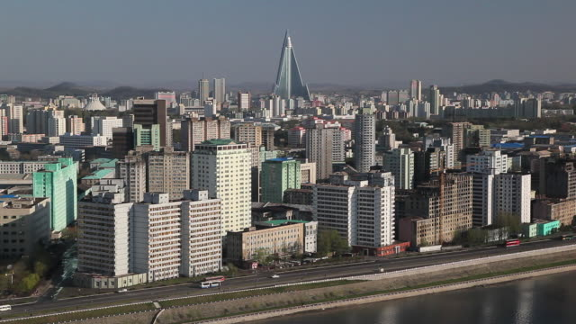 pyongyang's impressive skyline lines the taedong river. - north korea stock videos & royalty-free footage