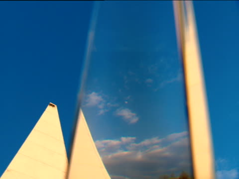 Pyramid building against blue sky seen through glass prism Russia