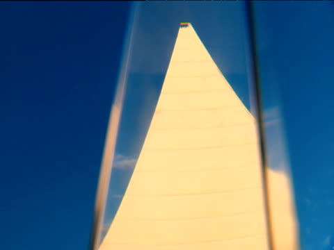 pyramid building against blue sky seen through glass prism russia - distorto video stock e b–roll