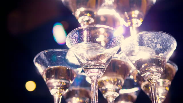 pyramid empty of champagne's glasses in wedding ceremony setup - champagne stock videos & royalty-free footage