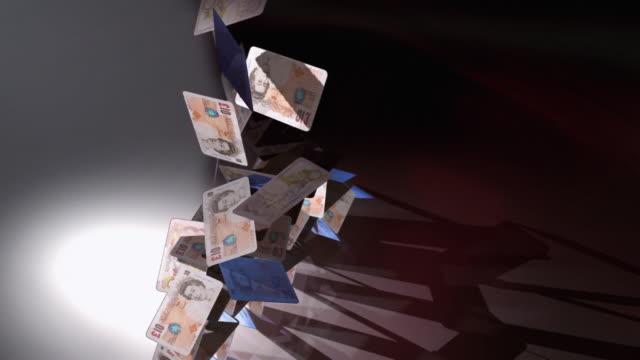 cgi, ha, slo mo, pyramid of british pound notes, falling, studio shot  - british pound sterling note stock videos & royalty-free footage