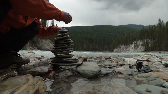 pyramid of stones in banff national park, alberta, canada - stacking stock videos & royalty-free footage
