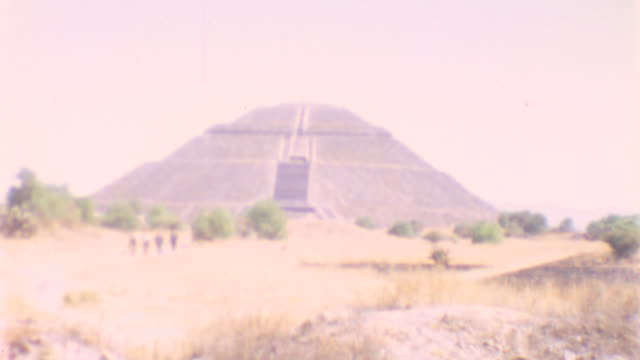 pyramid of the sun / walking tour / colored murals / pyramid of the sun on may 01 1962 in teotihuacan mexico - latin american civilizations stock videos and b-roll footage