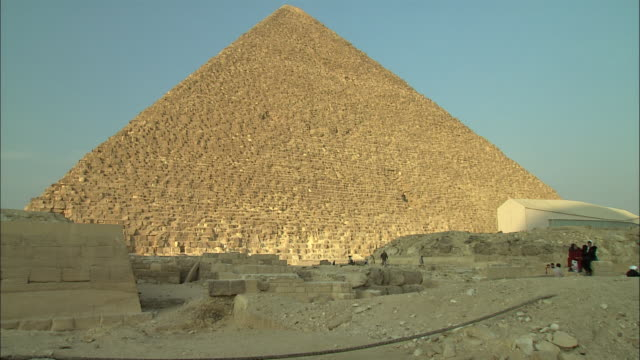 a pyramid stands in giza, egypt. - brick stock videos & royalty-free footage