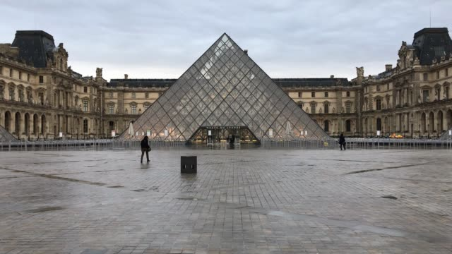 pyramide du louvre is seen at musee du louvre on april 02 2019 in paris france - mid adult stock videos & royalty-free footage