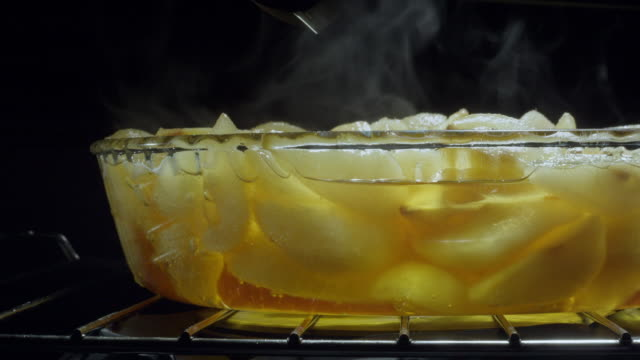 pyrex dish in oven - pears and spoon - bowl stock videos & royalty-free footage