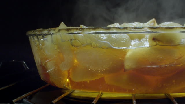pyrex dish in oven - pears - slow motion - detail - pear stock videos & royalty-free footage