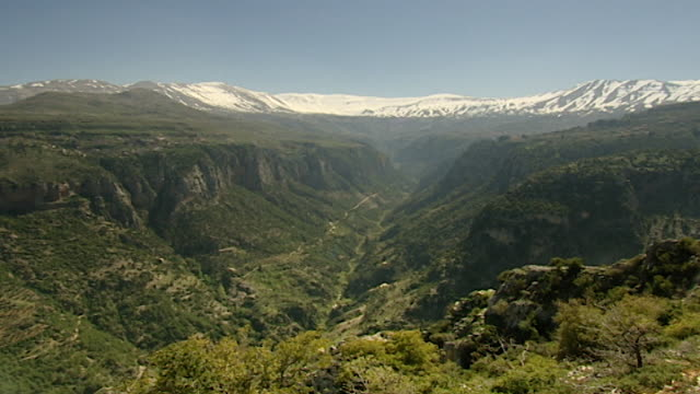 qadisha valley view the steep cliffsides of the qadisha gorge and snowcapped mount makmal in the distance the area is a unesco site - canyon stock videos & royalty-free footage