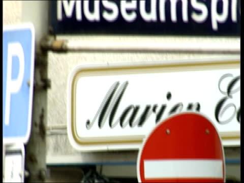 hamburg street signs tilt up road sign 'wilhemstrasse' - al qaida stock videos & royalty-free footage