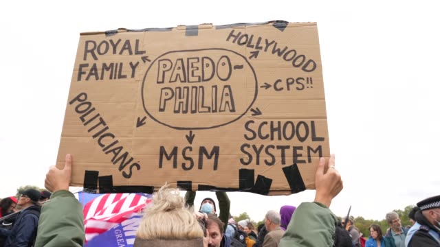vídeos de stock e filmes b-roll de qanon inspired banner linking members of high society to a paedophile ring during standupx march for freedom protest on october 17, 2020 in london,... - paranoia
