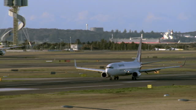 WS PAN Qantas plane taxiing on runway at Kingsford Smith Airport/ Sydney, Australia