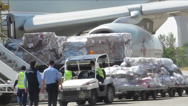 A Qatar Airways plane carrying aid from Doha for Iraqis displaced by a militant offensive that overran the countrys second biggest city Mosul arrived...