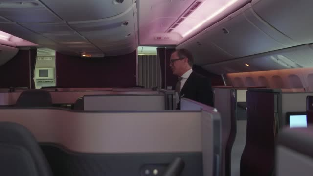 qatar airways unveil their new qsuite business class seats, including the world's first double bed in business class. includes interview with senior... - business travel stock videos & royalty-free footage