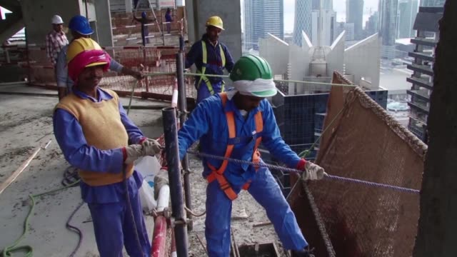 qatar has been accused of exploiting asian migrants working on one of its world cup stadiums in a new amnesty international report - golfstaaten stock-videos und b-roll-filmmaterial