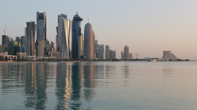 qatar, middle east, arabian peninsula, doha, new skyline of the west bay central financial district of doha - bay of water stock videos & royalty-free footage