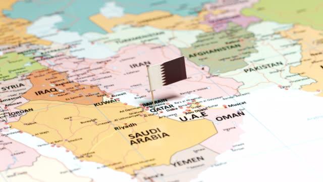 qatar with national flag - basra stock videos & royalty-free footage