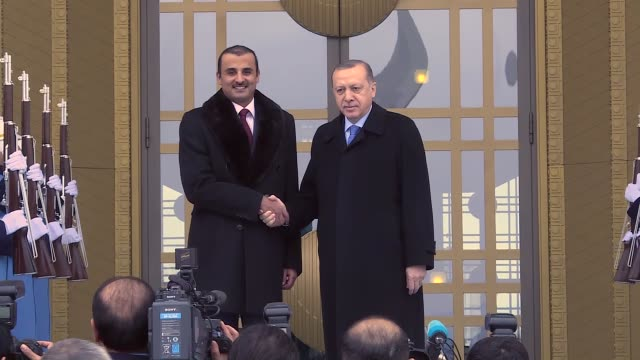 Qatari Emir Tamim bin Hamad Al Thani is welcomed by Turkish President Recep Tayyip Erdogan with an official welcoming ceremony prior to a meeting at...