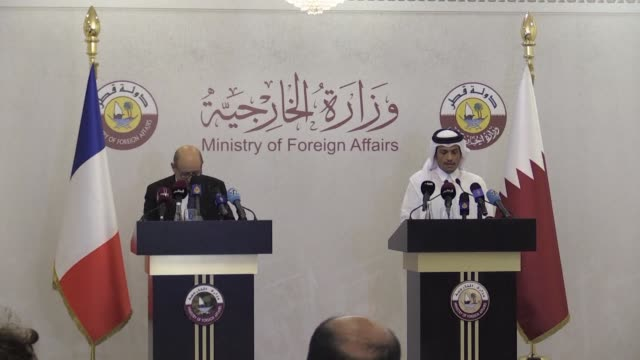 qatari foreign minister mohammed bin abdulrahman althani and his french counterpart jeanyves le drian give a press conference after signing monday an... - government minister stock videos & royalty-free footage