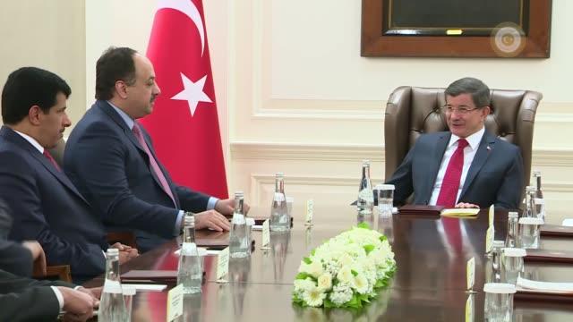 qatari minister of state for defense affairs, khalid bin mohammed al-attiyah meets with turkish prime minister ahmet davutoglu at the cankaya palace... - トルコ首相点の映像素材/bロール