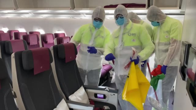 qatar's main airport ramps up virus prevention measures as it defies the global covid-19 aviation shutdown and remains open to allow stranded... - qatar stock videos & royalty-free footage