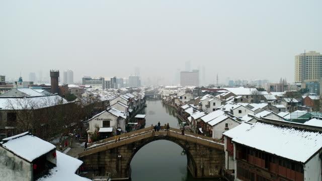qingming bridge ancient canal snow scene - arch bridge stock videos and b-roll footage