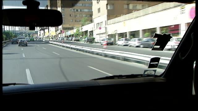 Qom mosque / Tehran road and tunnel Tehran SHOT along road / TRACKING SHOT through Tehran road tunnel / TRACKING SHOT along road