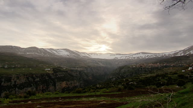 qornet el saouda mountain. wide angle view of sunrise over the mountian and the qadisha valley. - lebanon country stock videos & royalty-free footage