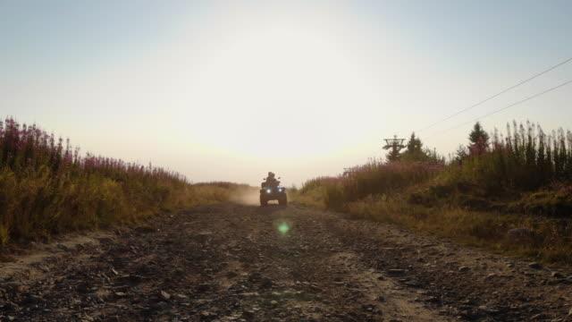 quad bike ride in sunset - quadbike stock videos & royalty-free footage