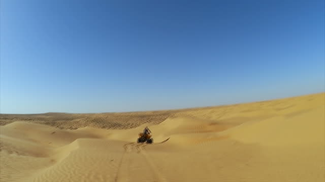quad tour in sahara desert near ksar ghilane , tunisia / africa - tunisia video stock e b–roll
