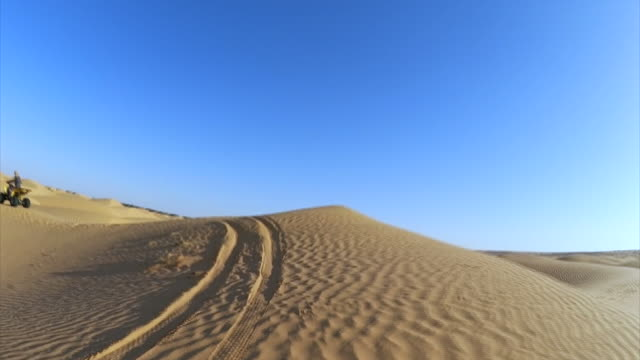 quad tour in sahara desert of tunisia / africa - tunisia video stock e b–roll