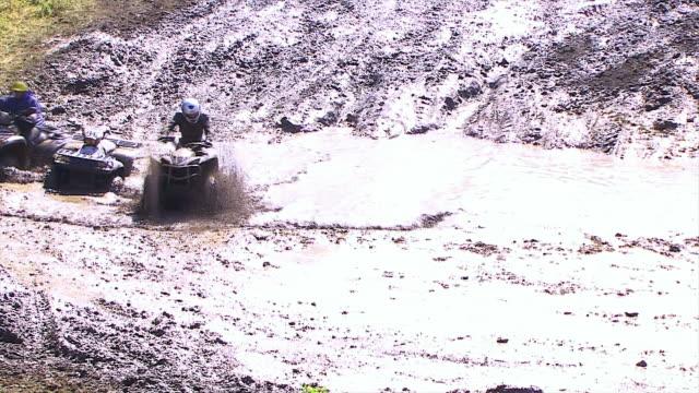 quadbike in water - quadbike stock videos & royalty-free footage